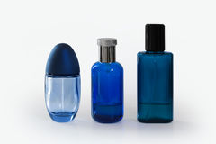 Blue fragrance bottles. Three blue Fragrances bottles on white background Stock Images