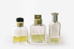 Transparent fragrance bottles. Three transparent fragrances bottles on white background Royalty Free Stock Photos