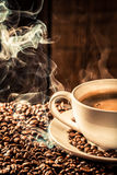 Fragrance coffee cup with roasted seeds Stock Photography