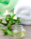 Fragrance oil. With bamboo, candle and towel Stock Photo