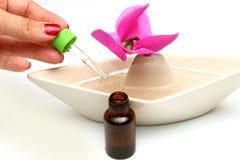 Fragrance oil bottles Stock Photos