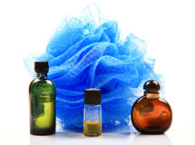 Fragrance oil bottles. With scrubber over white background Stock Photos