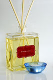 Fragrance oil with scented diffuser. And a blue candle holder Stock Photography