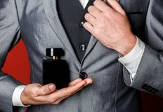Fragrance smell. Male fragrance, perfumery, cosmetics. Smell perfume. Expensive suit. Rich man prefers expensive. Fragrance smell. Man scent perfume. Perfume or royalty free stock image