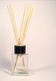 Fragrance Sticks in bottle. A small bottle with a black cap with fragrance sticks in it Royalty Free Stock Image