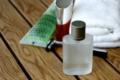 Fragrances Mens Accessories. Fragrances bottle and Mens Accessories in wooden tile Royalty Free Stock Photos