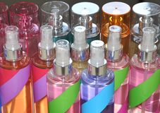 Fragrances and Sprays. Colorful containers of sweet smelling fragrances and sprays Royalty Free Stock Images