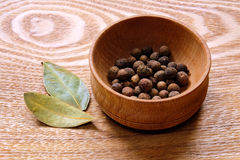 Fragrant black pepper and bay leaves. Stock Image