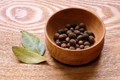 Fragrant black pepper and bay leaves. Stock Image