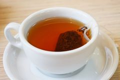 Fragrant black tea in a bag. Fragrant black tea in a bag in a white Cup royalty free stock photos