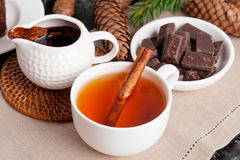 Fragrant black tea with cinnamon and chocolate, close up Stock Photography