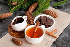 fragrant black tea with cinnamon and chocolate, close up Royalty Free Stock Photo