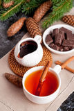 Fragrant black tea with cinnamon and chocolate, vertical Royalty Free Stock Photography