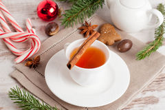 Fragrant black tea with cinnamon, gingerbread cookies with spice Stock Photo