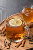 Fragrant black tea with lemon and cinnamon Royalty Free Stock Photography