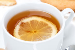 Fragrant black tea with lemon, close-up Stock Image