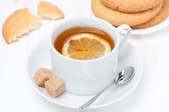 Fragrant black tea with lemon and cookies Stock Image