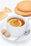 Fragrant black tea with lemon and cookies Royalty Free Stock Image