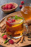 Fragrant black tea with lemon, mint, raspberry and cinnamon Royalty Free Stock Photo