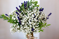 Fragrant bouquet of baby's breath with eucalyptus and lavender Stock Photos