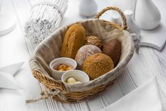 Fragrant bread and buns in a basket royalty free stock image