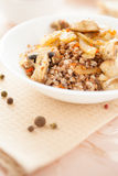 Fragrant buckwheat with fried mushrooms Stock Photography