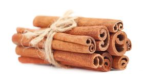 Fragrant dry cinnamon sticks isolated on white background. Cinnamon stick spice isolated on white background. Closeup. Fragrant cinnamon sticks isolated on white Royalty Free Stock Images