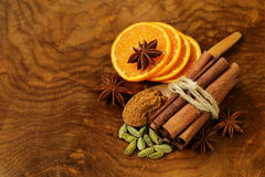 Fragrant cinnamon sticks, star anise, cardamom and orange Stock Photography