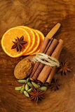 Fragrant cinnamon sticks, star anise, cardamom and orange Royalty Free Stock Photo