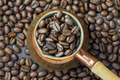Fragrant coffee beans in copper cezve, top view Royalty Free Stock Photography
