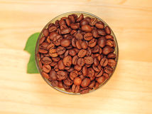 Fragrant coffee beans in glass jar Royalty Free Stock Images