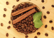 Fragrant coffee beans in wicker basket Royalty Free Stock Photography