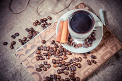 Fragrant coffee on a notebook, espresso cup and saucer Royalty Free Stock Image