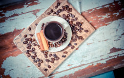 Fragrant coffee on a wooden background, espresso cup and saucer Stock Photo