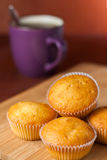 Fragrant cupcakes lie on a wooden table.  Stock Photography