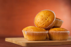 Fragrant cupcakes lie on a wooden table.  Royalty Free Stock Photography