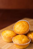 Fragrant cupcakes lie on a wooden table.  Royalty Free Stock Image