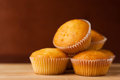 Fragrant cupcakes lie on a wooden table.  Stock Photos