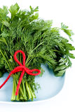 Fragrant dill and parsley leaves lie on the plate Stock Photos