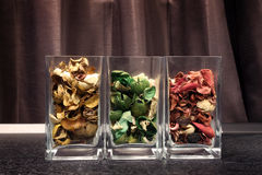 Fragrant dried flower petals in glass Stock Photos