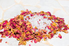 Fragrant dried rose petals with bath salts royalty free stock photos