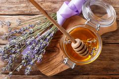 Fragrant fresh lavender honey in a glass jar close-up. horizontal top view. Fragrant fresh lavender honey in a glass jar close-up on a table. horizontal top view royalty free stock image