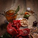 Fragrant fruit tea with tangerines, dried lemons and rosemary on a wooden table. Country style royalty free stock images
