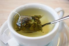 Fragrant green tea in a bag. Fragrant green tea in a bag in a white Cup stock image