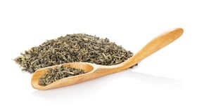 Fragrant green tea and wooden spoon Royalty Free Stock Photo