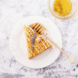 Fragrant homemade honey cake  with nuts and  lavender on gray concrete background    fresh  in the horizontal version Royalty Free Stock Photography
