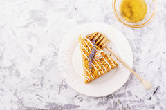 Fragrant homemade honey cake  with nuts and  lavender on gray concrete background    fresh  in the horizontal version Stock Photos
