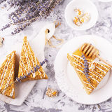 Fragrant homemade honey cake  with nuts and  lavender on gray concrete background    fresh  in the horizontal version Stock Photo