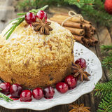 Fragrant homemade muffins with cranberries, candied fruits soaked in brandy, herbs and spices on a wooden dark Stock Photos