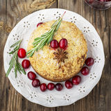 Fragrant homemade muffins with cranberries, candied fruits soaked in brandy, herbs and spices on a wooden dark Stock Photo